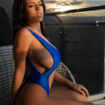 Autumn Falls posing in one piece blue bikini