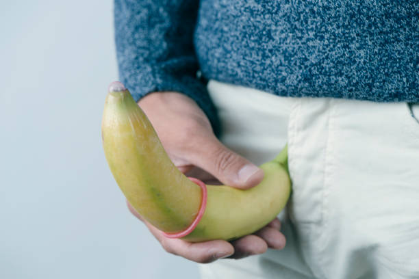 Man holding banana to demonstrate curvature of penis